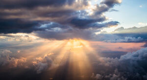 Cloudscape at sunset with sunlight streaming through clouds